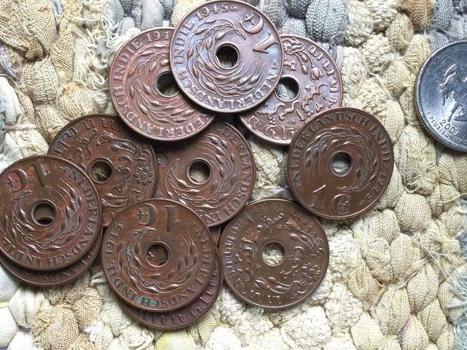 kenapa kebanyakan syiling kuno mempunyai lubang 1