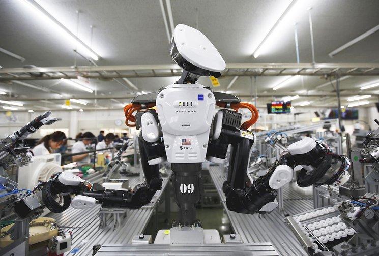 robot yang dipasang dikilang