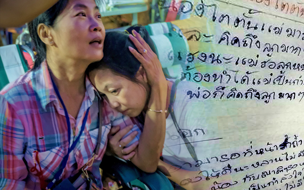 thai family receive letter from kids stuck in cave